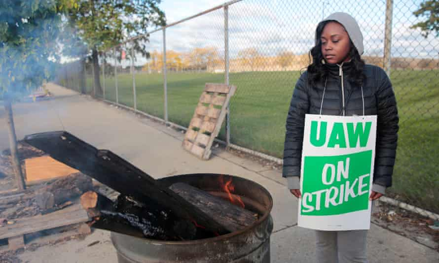 Striking United Auto Workers member Anesha Towell keeps warm at a burn barrel while picketing at the General Motors Detroit-Hamtramck Assembly in Detroit, Michigan, on Thursday.