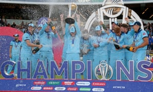 England v New Zealand, Cricket, Cricket World Cup 2019, Final, Lord's Cricket Ground, London, UK - 14/07/2019<br>Mandatory Credit: Photo by Matthew Impey/REX/Shutterstock (10334036ai) England players cover captain Eoin Morgan in Champagne as they celebrate winning the World Cup England v New Zealand, Cricket, Cricket World Cup 2019, Final, Lord's Cricket Ground, London, UK - 14/07/2019