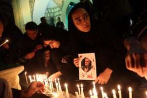 Supporters light candles in memory of Qasem Souleimani.