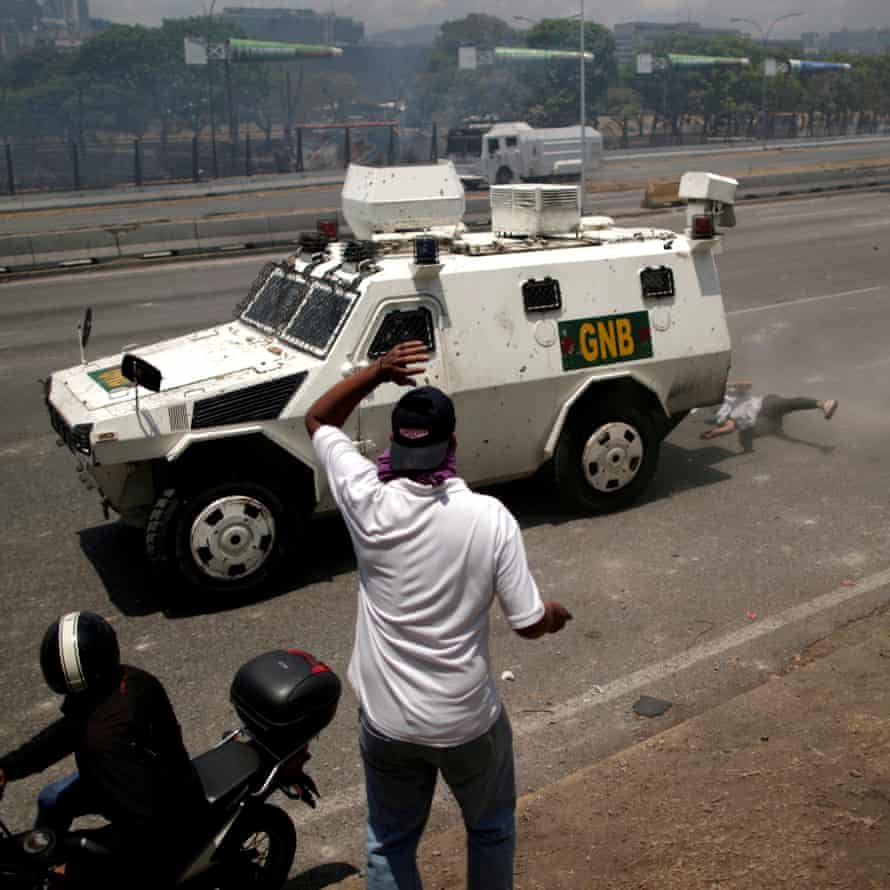 Luis Alejandro, 26, an opposition demonstrator, is struck by a Venezuelan national guard vehicle in Caracas, 30 April