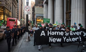 Activists march to New York's City Hall to demand more affordable housing options for the homeless and poor.