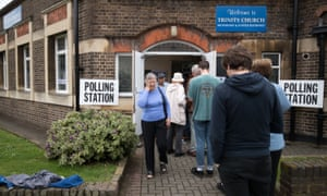 Voters queue to enter a polling station at Trinity Church in Golders Green on June 23, 2016 in London