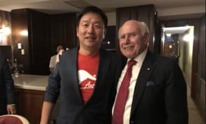 Jason Zong at a Liberal National party event with former prime minister John Howard.