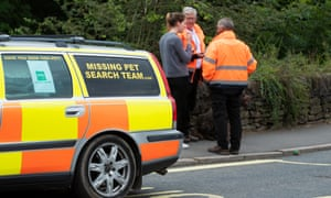 A team searching for missing pets in Whaley Bridge.