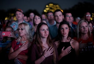Supporters of Republican presidential candidate Donald Trump recite the pledge of allegiance at a campaign rally in Panama City, Florida