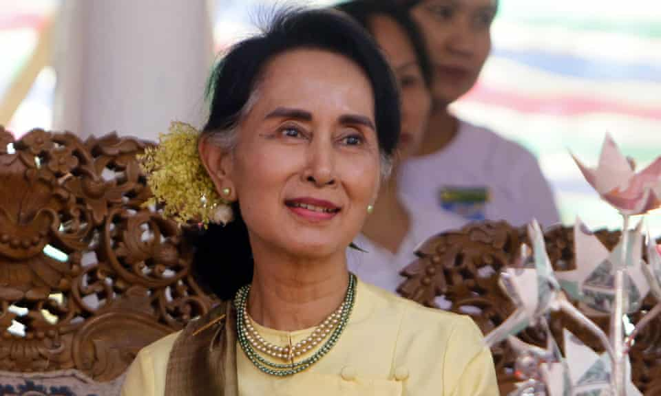 Aung San Suu kyi smiles during a ceremony in Naypyidaw, Myanmar.