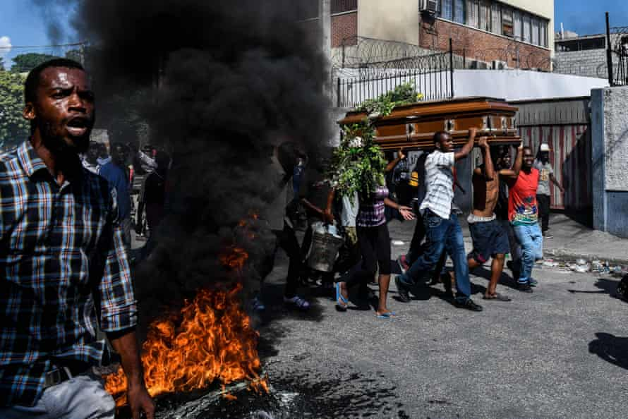 People carry a coffin to a funeral organised by the opposition in Port-au-Prince in October 2019 after weeks of anti-corruption protests demanding Moïse's resignation.