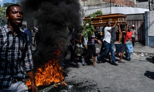 A coffin is borne in Port-au-Prince, Haiti, where violent anti-government protests were frequent last year