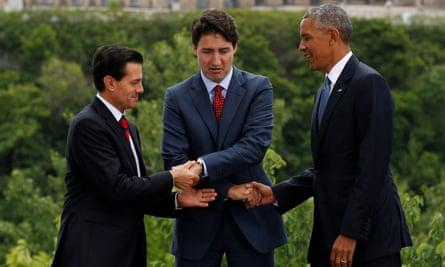 Mexico's president, Enrique Pena Nieto, Canada's prime minister, Justin Trudeau, and US President Barack Obama shake hands in Ottawa, Ontario on 29 June 2016.