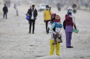 A Nepali woman carries her child in Kathmandu, Nepal