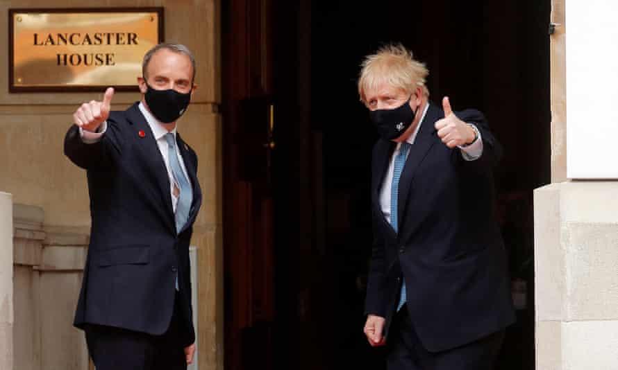 Raab (left) and Boris Johnson arrive at the G7