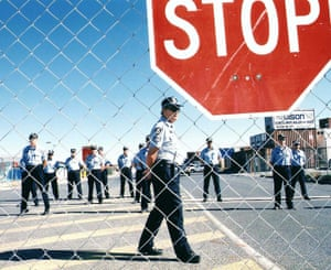 Police on the docks in Fremantle during the 1998 waterfront dispute. The ability of workers to organise and strike has been severely restricted since the 1980s.