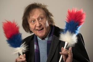 Ken Dodd OBE poses for a portrait after he officially opened the refurbished St John's Market on 25 November, 2016 in Liverpool, England.