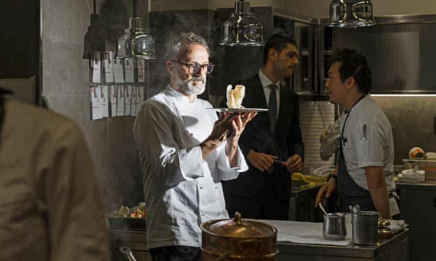 Chef Massimo Bottura with his dish The Crunchy Part Of The Lasagne.