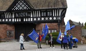 Anti-Brexit campaigners outside Thornton Manor Hotel, near Birkenhead, where Boris Johnson is meeting Leo Varadkar.