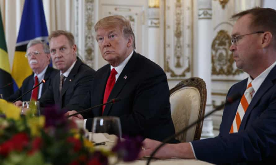 Donald Trump is flanked by the acting defense secretary, Patrick Shanahan, left, and Mick Mulvaney, his acting chief of staff, at a meeting with Caribbean leaders in Mar-a-Lago last month.