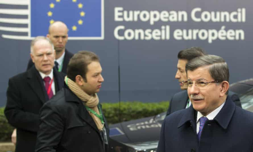 Turkish prime minister Ahmet Davutoğlu, right, arrives for an EU summit in Brussels.