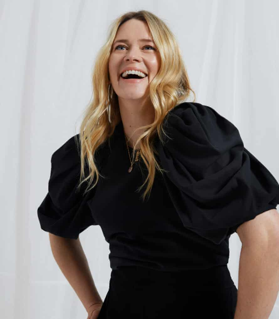 Edith Bowman, in a black top and trousers, laughing