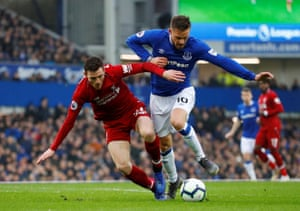 Sigurdsson stays on his feet after the challenge from Robertson.
