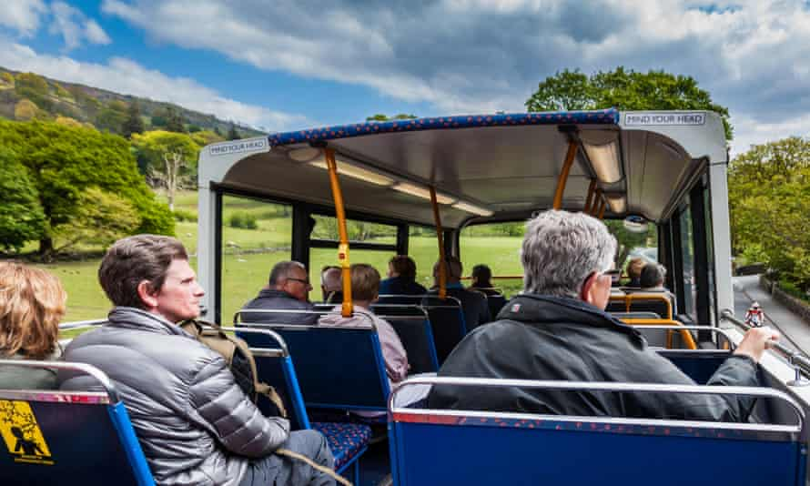 Visitors on the open top 599 service bus from Bowness on Windermere to Grasmere, Windermere, Lake District, Cumbria