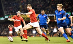 Wales' George North attempts to kick the ball forward before scoring a try