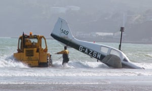 A tractor tows a plane from the waves after it crashed on Sandown beach in 2007.