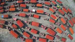 Inner Mongolia , China: Tractors pulling loads of tomatoes line up at a vegetable processing factory in Sandaoqiao, Inner Mongolia Autonomous Region