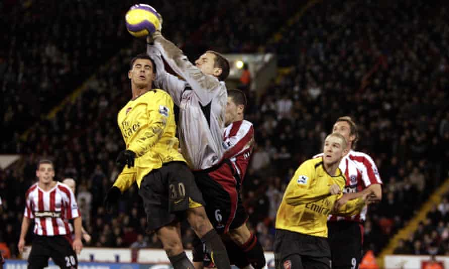 Phil Jagielka claims a high ball above Arsenal's Jeremie Aliadiere during his stint in goal back in 2006