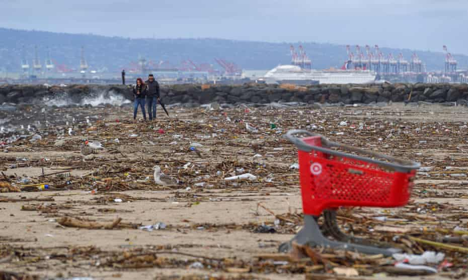 Trash is strewn along the sand south of the San Gabriel River in Seal Beach on 4 February 2019.