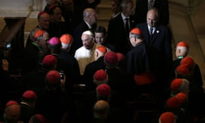Pope Francis, center, greets clergy after addressing a gathering in Saint Martin's Chapel at St. Charles Borromeo Seminary on Sunday/