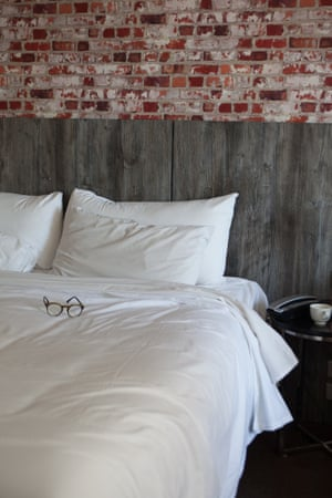 Glasses on a hotel bed