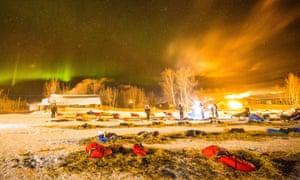 Under the northern lights, Norwegian rookie Thomas Waerner prepares to leave Huslia, Alaska, for Koyukuk in the Iditarod Trail Sled Dog Race