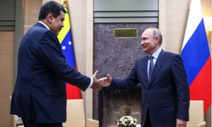 Nicolás Maduro and Vladimir Putin shake hands during a meeting at the Novo-Ogaryovo residence in Russia on 5 December.