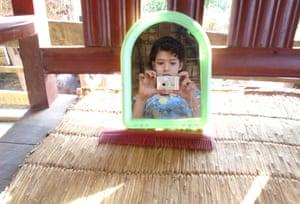 Bandana Khadka takes a self-portrait in the mirror.