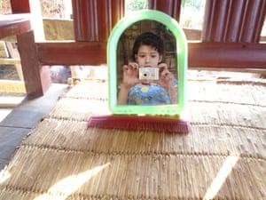 Bandana Khadka takes a self-portrait in the mirror
