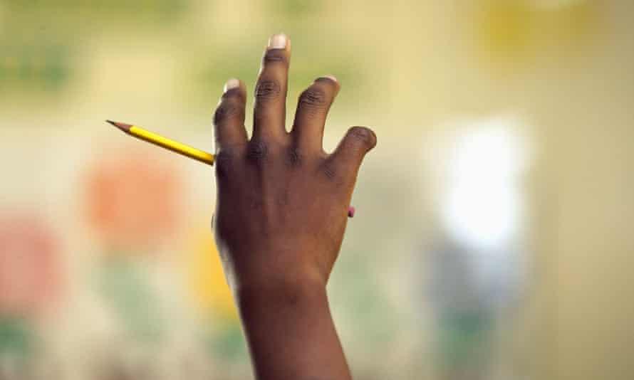 Close up of African boy raising hand