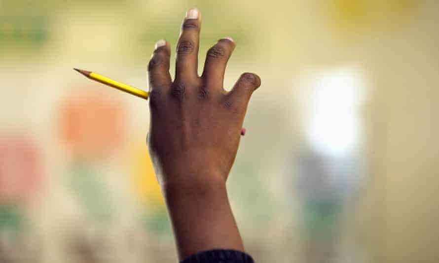 black boy raising hand