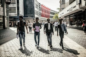 From left: Aman, Amanuel and Aminadab with a friend from Eritrea, walking in Bielefeld, Germany