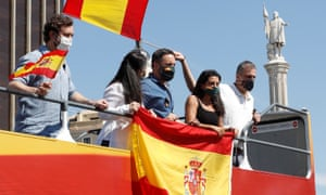 The Vox party's leader, Santiago Abascal, centre, and colleagues onboard a bus during a protest in Madrid on Saturday