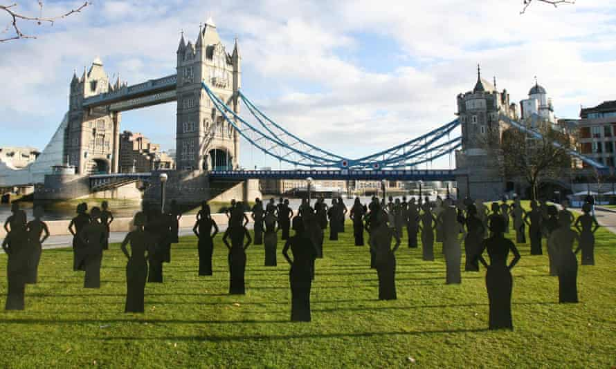 Female silhouettes stand in Potters Fields Park in central London