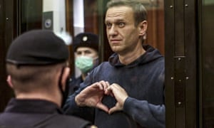 Russian opposition leader Alexei Navalny makes a heart gesture