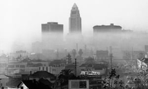 Los Angeles, 1958. On such days, a layer of warm air - temperature inversion - acts as a cover keeping impurities near the ground. Los Angeles officials claim automobiles cause most of the smog. Automotive and gasoline industries have been asked by the city to help in the fight against smog. (AP Photo)