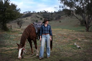 Mulla Creek, Australia. Leconfield jillaroo (cowgirl) Sara Dewint with her horse Billy. Men and women come from all over the world to experience farm work in the Australian outback.