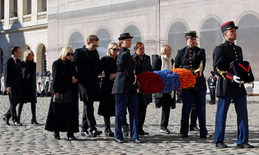 Emmanuel and Brigitte Macron follow the coffin of Charles Aznavour, alongside his family, in Paris,