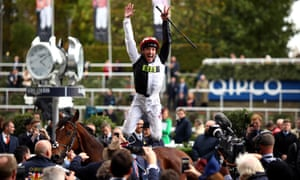 Frankie Dettori celebrates with his trademark flying dismount after riding Cracksman to victory in the Champion Stakes at Ascot.