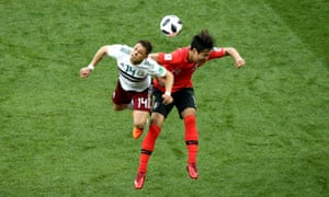 Javier Hernandez wins a header over Kim Young-Gwon