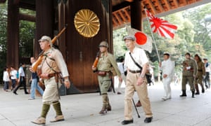 Men wearing Japanese imperial military uniform visit the Yasukuni Shrine in Tokyo, marking the 74th anniversary of the end of the war in the Pacific.