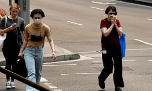People are seen wearing face masks in Sydney