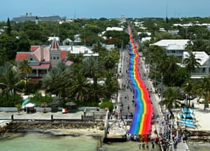 The world's longest rainbow flag is unfurled for PrideFest in Key West, Florida, June 2003. The 8,000ft-long flag was created by Gilbert Baker, who designed the original flag in 1978