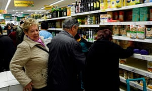 A busy supermarket in the Usera neighbourhood of Madrid, where many people have begun stockpiling food.